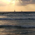 Two boats and waves at sunset in north Tel-Aviv beach by Ilan Cohen
