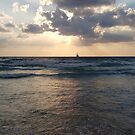 Two boats collide into one on the waves at sunset in north Tel-Aviv beach by Ilan Cohen