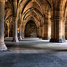 Pillars and arches underneath Glasgow University by Paul Messenger