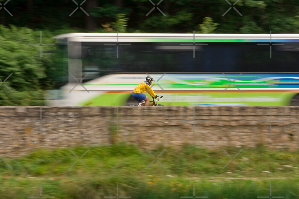 The Cyclist and the Tour Bus by Buckwhite