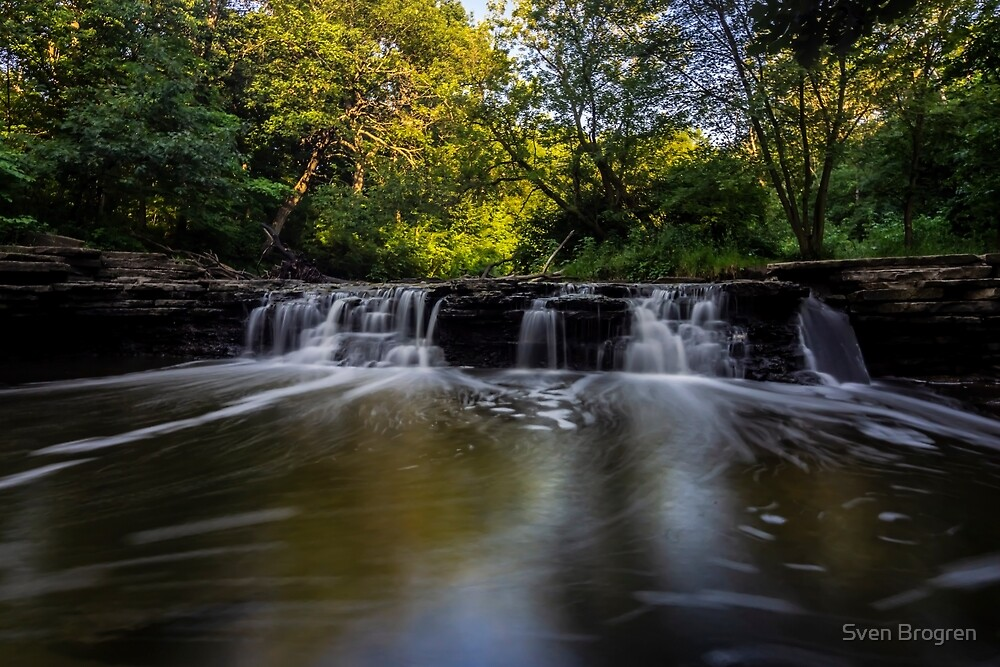Cascading waterfall with rising morning sun  by Sven Brogren