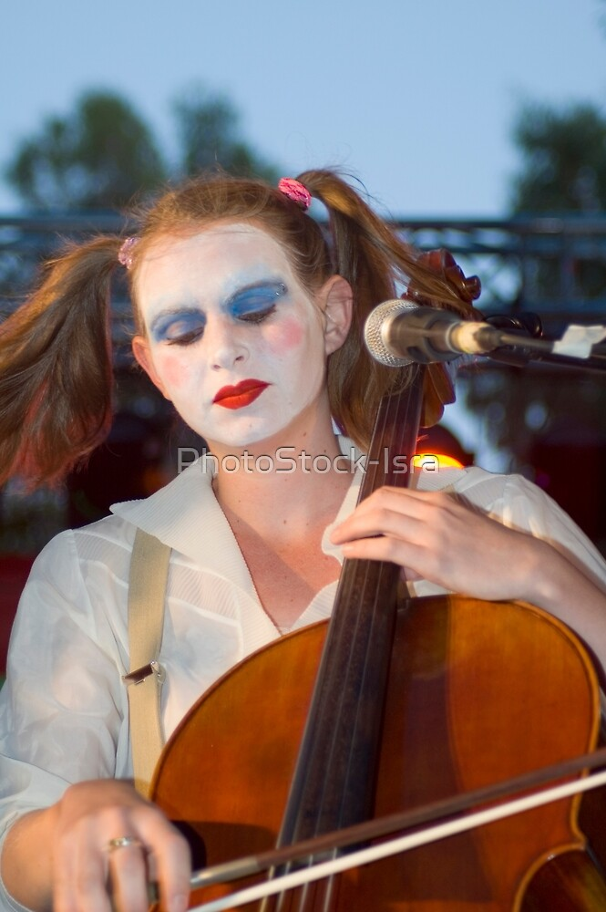 Musician dressed and made up as a clown playing a cello on stage by PhotoStock-Isra