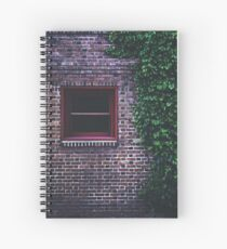 Texture Brick wall red bricks with climbing green vines wild plants and rustic red wooden window vintage grunge style urban pattern Spiral Notebook
