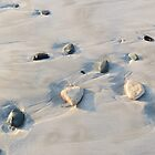 Pebbles on the sand by Elizabeth Kendall