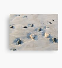Pebbles on the sand Canvas Print