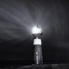 Lighthouse at night by Joel Tjintjelaar