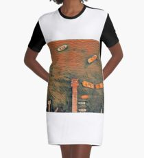 Surreal orange and black lake pier with boats Graphic T-Shirt Dress