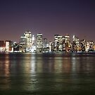 Lights of Manhattan at night reflecting in the Hudson river by viaterra-photos