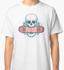 Skull holds a skateboard in his teeth  Classic T-Shirt