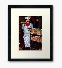 The Baker Framed Print