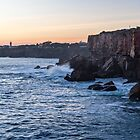 Rough Coast at Sunset - the Sea Cliffs and Farol da Guia Lighthouse in Cascais Lisbon Portugal by Georgia Mizuleva