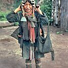 Akha mother by John Spies