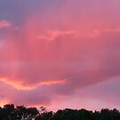 Sun setting on Storm Clouds by MaeBelle