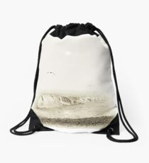 Gulls flying over breaking waves during a sea mist Drawstring Bag