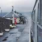 Guard sending off train at Kyle of Lochalsh for Inverness Scotland 19840917 0017  by Fred Mitchell
