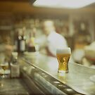 Glass of beer in Spanish tapas bar square Hasselblad medium format  c41 color film analogue photograph by edwardolive