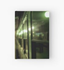 Old train at night in empty station green square Hasselblad medium format film analog photograph Hardcover Journal