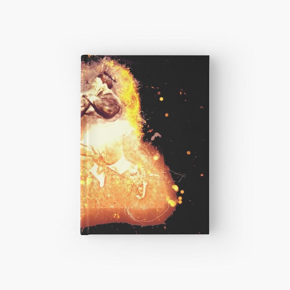 Sumoringer athlete burning Notizbuch