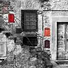 Bracciano: staircase with colored mailboxes by Giuseppe Cocco