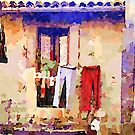 Bracciano: clothes hanging seen from the alley by Giuseppe Cocco