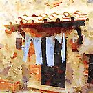 Bracciano: clothes hanging under the shelter by Giuseppe Cocco