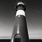 Lighthouse and startrails by Joel Tjintjelaar