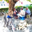 Albania: bicycles with men sitting a Fier park by Giuseppe Cocco