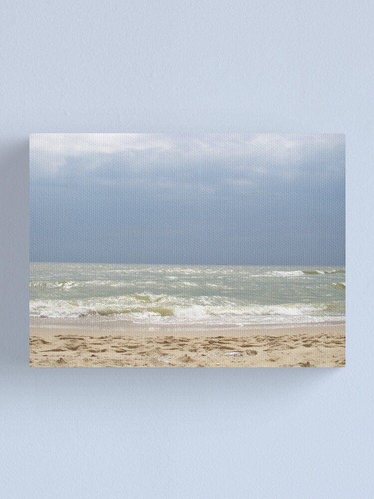Alternate view of The sky and the sea communicating through the ray of light Canvas Print