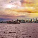 Seattle Washington city skyline along Elliot Bay in Puget Sound from Alki Beach during sunset by davidgnsx1