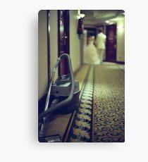 Wedding bride and groom and vacuum cleaner in hotel corridor Canvas Print