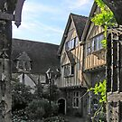 Cheyney Court seen through the gateway to Winchester Cathedral Close, southern England by Philip Mitchell