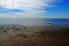 Stranded White Dinghy at Low Tide by Extraordinary Light