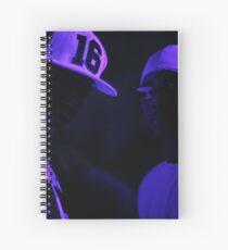Hip hop rap gangster rappers singers at night in dark nightclub bar lit in pink black light wearing baseball caps Spiral Notebook