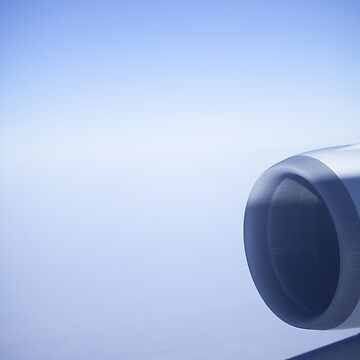 Jumbo jet airplane wing engine in flight flying over blue sky photo by edwardolive