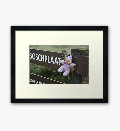 Poor little baby aren't you cold? Framed Print
