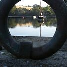 Boat through mooring ring by Alice Oates