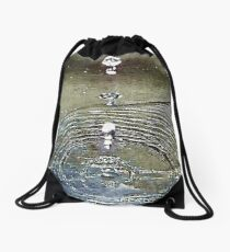 Molecules vibrating in harmony with radiant energy. Drawstring Bag