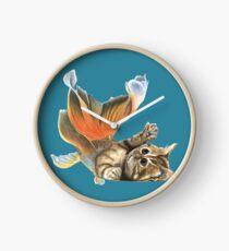 Mercat spielt mit seinem Schwanz Uhr