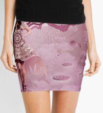 Model in Pink Mini Skirt