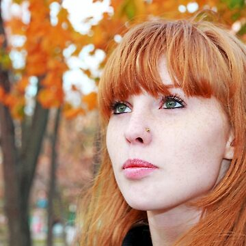 Pretty red hair girl face with freckles against of the autumn foliage. by IaroslavB