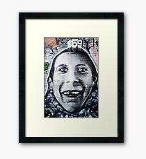 Graffiti Face of teethless boy Framed Print
