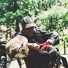 MAN + SQUIRREL IN WASHINGTON SQUARE PARK, NYC, 2018 by Marc Zahakos