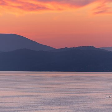 In the Scale of Things, a lone fishing boat on Lago Trasimeno at dawn by AndyJones