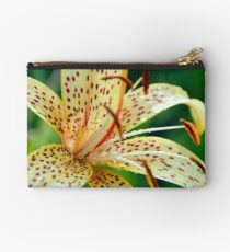 Yellow lily speckled macro growing in garden Studio Pouch