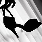 Silhouette of hand holding dance shoe by GemaIbarra