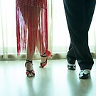 Closeup of legs of two professional latin dancers by GemaIbarra