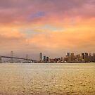 San Francisco CA city skyline and Oakland Bay Bridge during sunset panorama by davidgnsx1