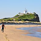 LONE SURFER - NOBBY'S BEACH NEWCASTLE NSW by Bev Woodman