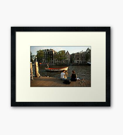 Two young women and a boatman Framed Print