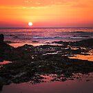 Fiery orange sunset in Cornwall by Chris Warham